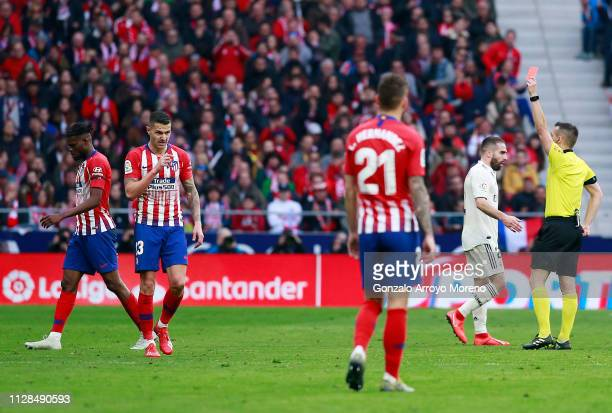 Referee Estrada Fernandez shows a red card and sends off Thomas Partey of Atletico Madrid during the La Liga match between Club Atletico de Madrid...