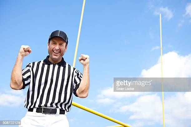 referee: excited ref cheers to camera - american football judge stock pictures, royalty-free photos & images