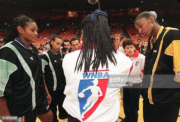 WNBA referee explains the rules of the game to Los Angeles Sparks center Lisa Leslie and New York Liberty player Trena Trice during the WNBA opening...