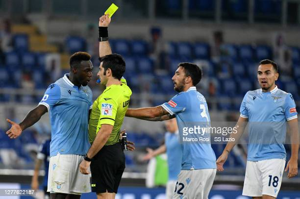 Referee Fabio Maresca shows a yellow card at Felipe Caicedo of SS Lazio during the Serie A match between SS Lazio and Atalanta BC at Stadio Olimpico...