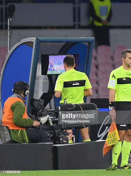 Referee Fabrizio Pasqua at the VAR position during the Serie A match between SSC Napoli and Genoa CFC at Stadio San Paolo on April 7, 2019 in Naples,...