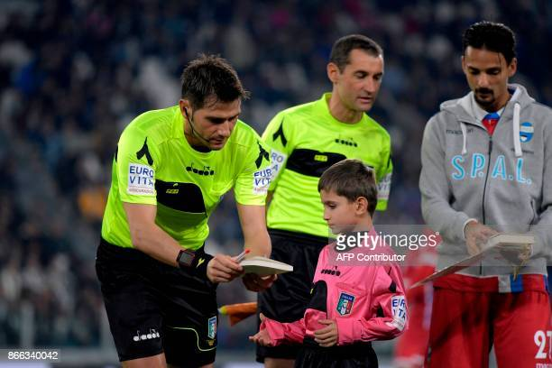 Referee Fabrizio Pasqua gives a copy of the diary of holocaust victim Anne Frank to a boy before the Italian Serie A football match Juventus vs Spal...