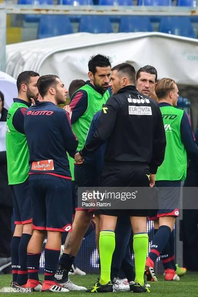 Referee Fabrizio Pasqua tells Andrea Biraschi Andrea Bertolacci Nicolas Spolli and Andrey Galabinov of Genoa Davide Astori of Fiorentina has been...
