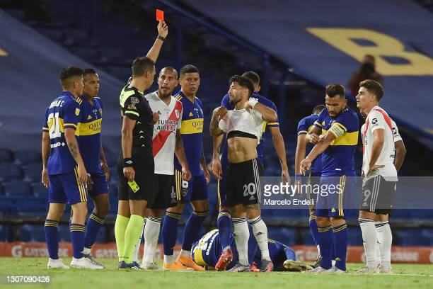 Referee Facundo Tello shows a red card to Milton Casco of River Plate during a match between Boca Juniors and River Plate as part of Copa De La Liga...
