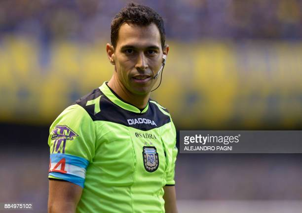 Referee Facundo Tello wears an armband with the colors of the Argentine flag and the number '44' in homage to the 44 crew members of the ARA San Juan...