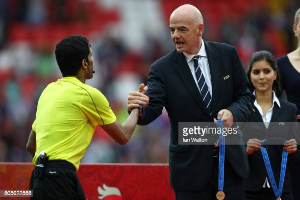 Referee Fahad Al Mirdasi collects his medal from Gianni Infantino FIFA president after the FIFA Confederations Cup Russia 2017 PlayOff for Third...