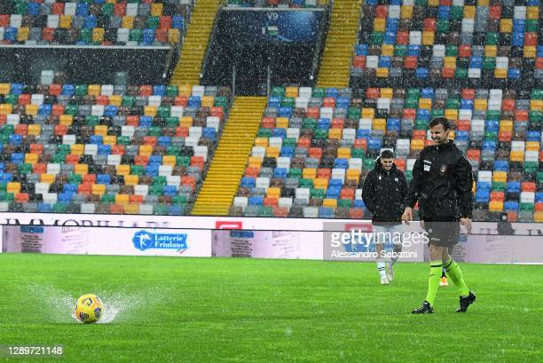 Referee Federico La Penna tests the bounce of the ball before the Serie A match between Udinese Calcio and Atalanta BC at Dacia Arena on December 06,...
