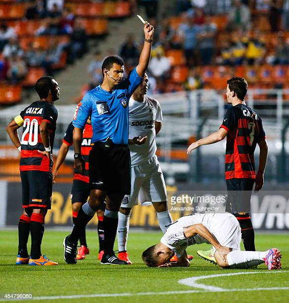 Referee Felipe Gomes da Silva in action during the match between Santos and Vitoria for the Brazilian Series A 2014 at Pacaembu stadium on September...