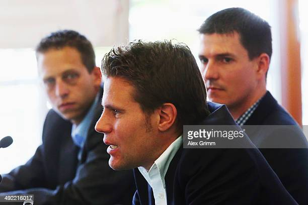Referee Felix Brych and his assistant referees Stefan Lupp and Mark Borsch attend a press conference of the German FIFA 2014 World Cup referees at...