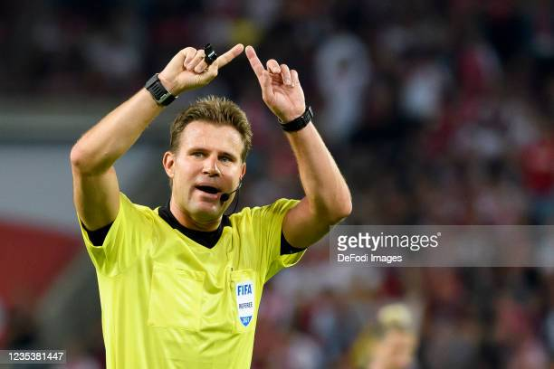 Referee Felix Brych gestures during the Bundesliga match between 1. FC Koeln and RB Leipzig at RheinEnergieStadion on September 18, 2021 in Cologne,...
