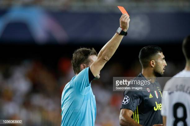 Referee Felix Brych gives Cristiano Ronaldo red card during the UEFA Champions League match between Valencia v Juventus at the Estadio de Mestalla on...