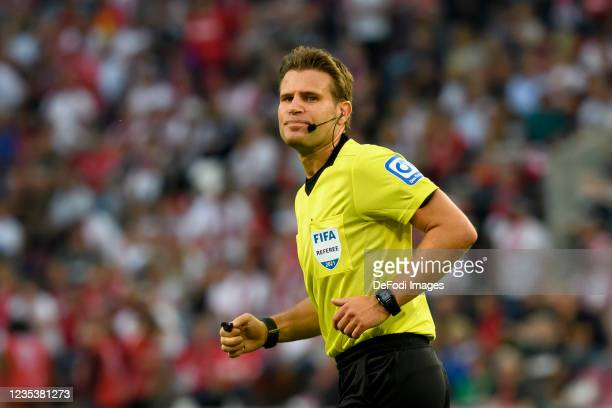 Referee Felix Brych looks on during the Bundesliga match between 1. FC Koeln and RB Leipzig at RheinEnergieStadion on September 18, 2021 in Cologne,...