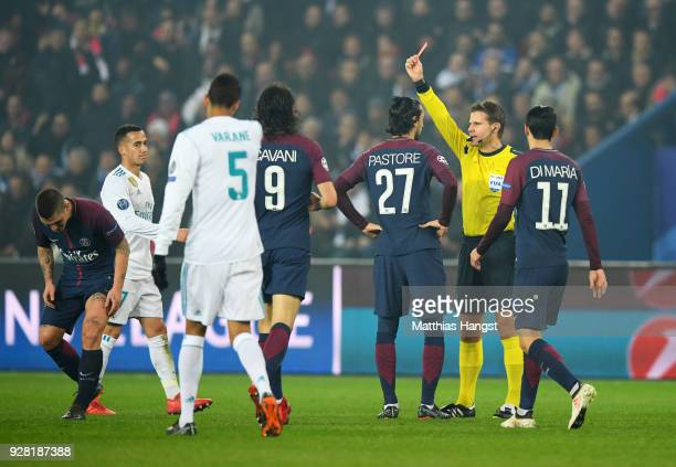 Referee Felix Brych shows a red card to Marco Verratti of PSG as he is sent off during the UEFA Champions League Round of 16 Second Leg match between...