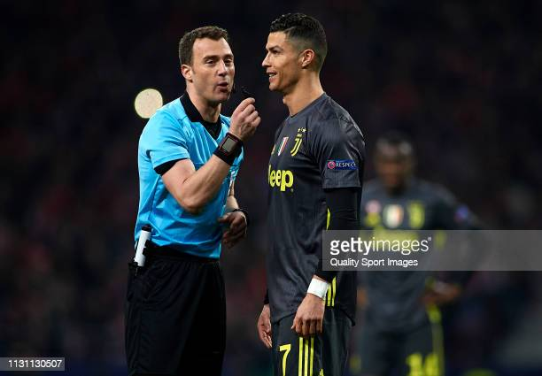 Referee Felix Zwayer and Cristiano Ronaldo of Juventus talks during the UEFA Champions League Round of 16 First Leg match between Club Atletico de...