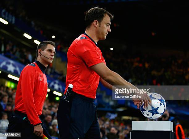 Referee Felix Zwayer collects the match ball during the UEFA Chanmpions League group G match between Chelsea and Maccabi TelAviv FC at Stamford...