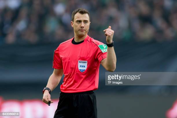 Referee Felix Zwayer gestures during the Bundesliga match between Borussia Moenchengladbach and RB Leipzig at BorussiaPark on February 19 2017 in...