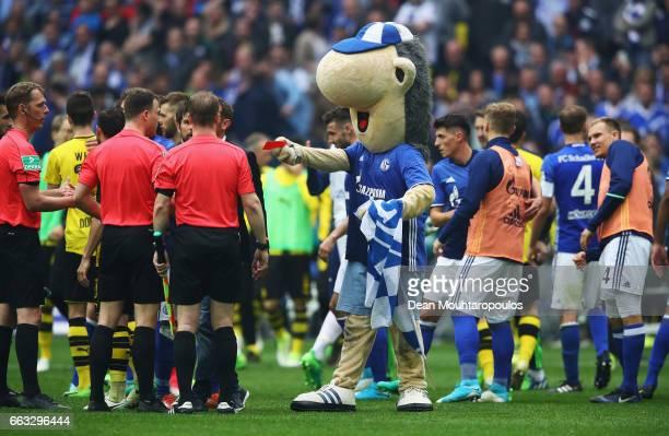 Referee Felix Zwayer is shown a red card by the Schalke mascot Erwin after the Bundesliga match between FC Schalke 04 and Borussia Dortmund at...