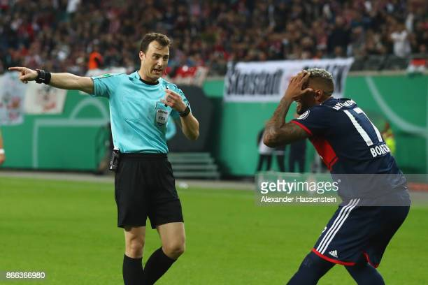 Referee Felix Zwayer point a penalty during the DFB Cup round 2 match between RB Leipzig and Bayern Muenchen at Red Bull Arena on October 25 2017 in...