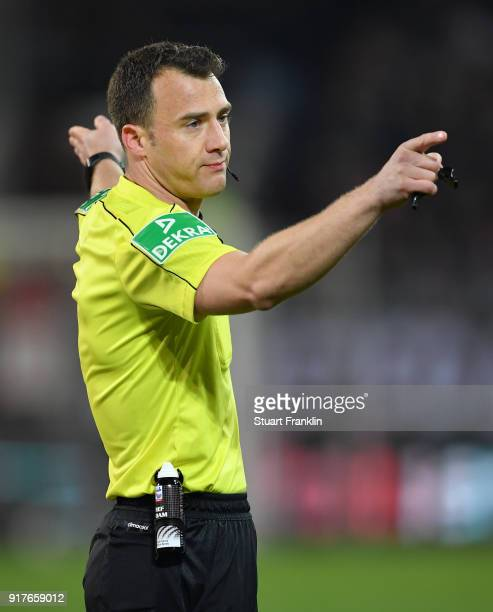 Referee Felix Zwayer points during the Second Bundesliga match between FC St Pauli and 1 FC Nuernberg at Millerntor Stadium on February 12 2018 in...