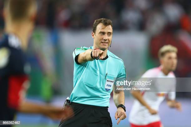 Referee Felix Zwayer reacts during the DFB Cup round 2 match between RB Leipzig and Bayern Muenchen at Red Bull Arena on October 25 2017 in Leipzig...