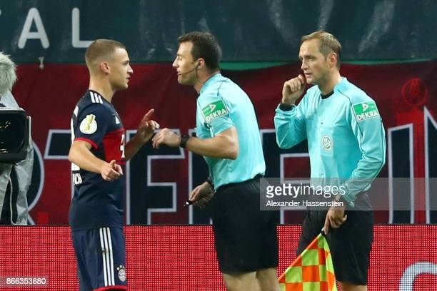 Referee Felix Zwayer reacts to Joshua Kimmich of Bayern Muenchen as he talks to assistent referee Thorsten Schiffner during the DFB Cup round 2 match...