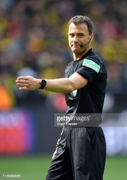 Referee Felix Zwayer signals during the Bundesliga match between Borussia Dortmund and FC Schalke 04 at Signal Iduna Park on April 27 2019 in...