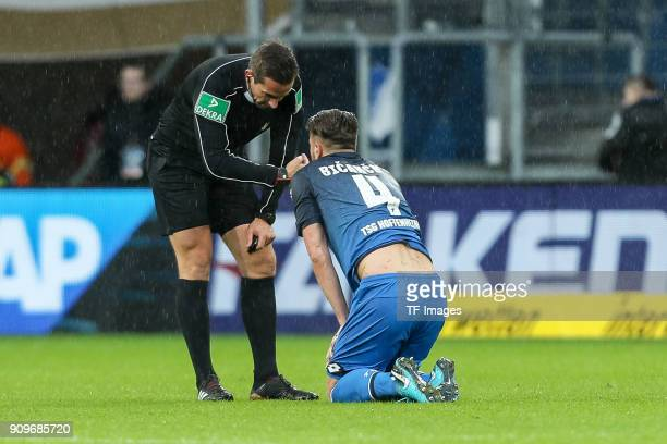 Referee Felix Zwayer speaks with Ermin Bicakcic of Hoffenheim during the Bundesliga match between TSG 1899 Hoffenheim and Bayer 04 Leverkusen at...