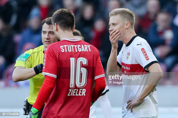 Referee Felix Zwayer speaks with Goalkeeper RonRobert Zieler of Stuttgart and Timo Baumgartl of Stuttgart during the Bundesliga match between VfB...