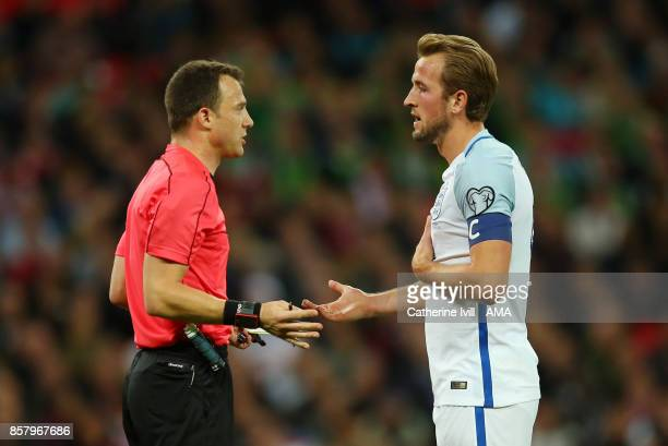 Referee Felix Zwayer talks to captain Harry Kane of England during the FIFA 2018 World Cup Qualifier between England and Slovenia at Wembley Stadium...