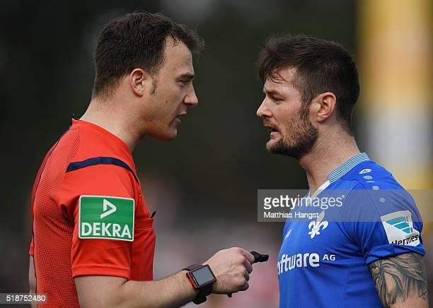 Referee Felix Zwayer talks to Marcel Heller of Darmstadt during the Bundesliga match between SV Darmstadt and VfB Stuttgart at MerckStadion am...