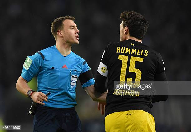 Referee Felix Zwayer talks with Mats Hummels of Dortmund during the Bundesliga match between Hamburger SV and Borussia Dortmund at Volksparkstadion...