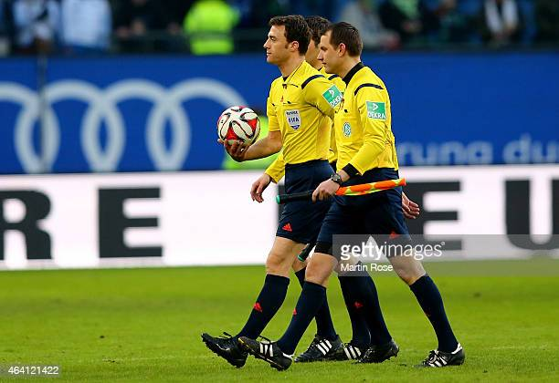 Referee Felix Zwayer walks off after the Bundesliga match between Hamburger SV and Borussia Moenchengladbach at Imtech Arena on February 22 2015 in...