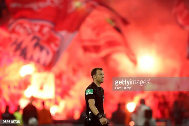 Referee Felix Zwayer walks on the pitch during the DFB Cup final between Bayern Muenchen and Eintracht Frankfurt at Olympiastadion on May 19 2018 in...