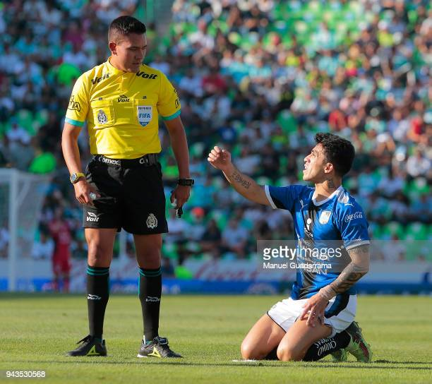 Referee Feranando Guerrero argues with Edson Puch of Queretaro during the 14th round match between Santos Laguna and Querataro as part of the Torneo...