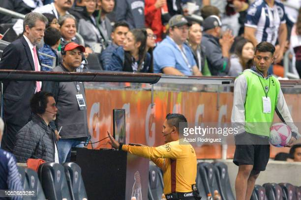 Referee Fernando Guerrero examines a play in the VAR system to determine if Alexis Gonzalez's goal was valid during the 13th round match between...