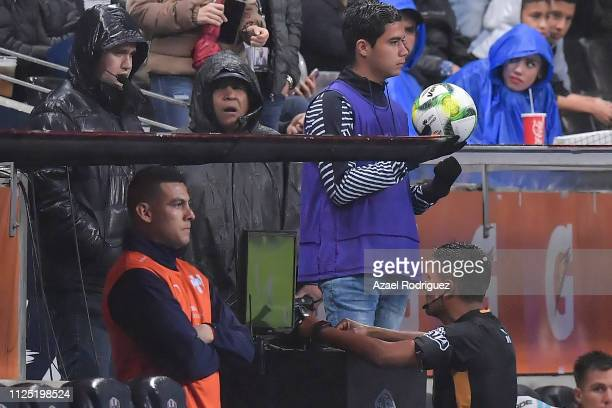 Referee Fernando Guerrero uses the VAR to confirm a penalty during the 4th round match between Monterrey and America as part of the Torneo Clausura...