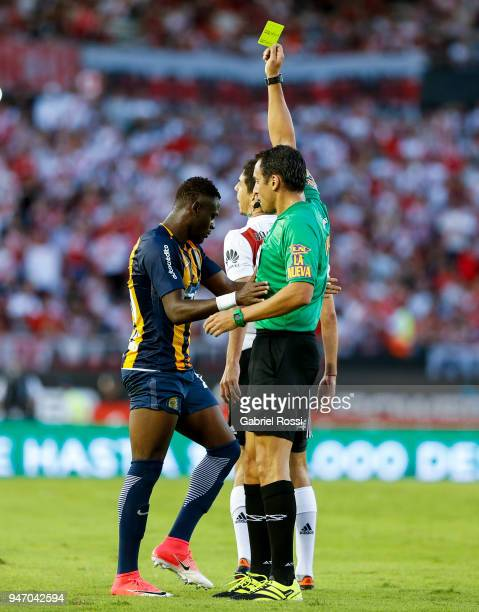 Referee Fernando Rapallini shows a yellow card to Oscar Cabezas of Rosario Central during a match between River Plate and Rosario Central as part of...