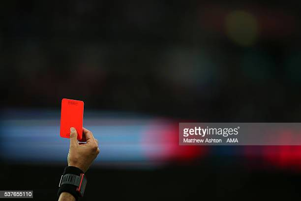 Referee Fernando Santos from Italy shows a red card during the International Friendly match between England and Portugal at Wembley Stadium on June 2...