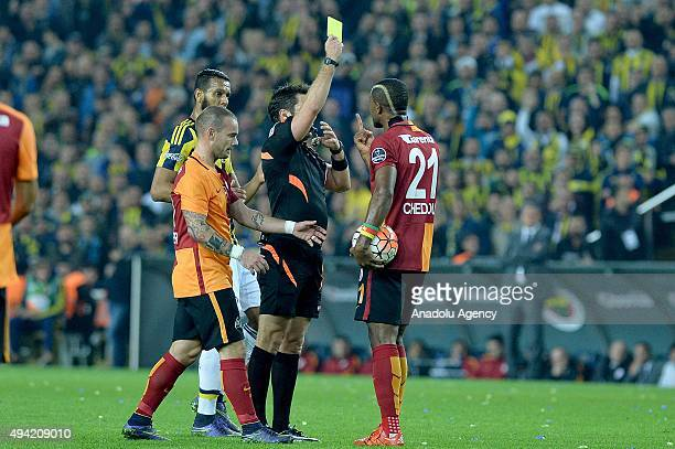 Referee Firat Aydinus shows yellow card to Chedjou of Galatasaray during the Turkish Spor Toto Super League football match between Fenerbahce and...