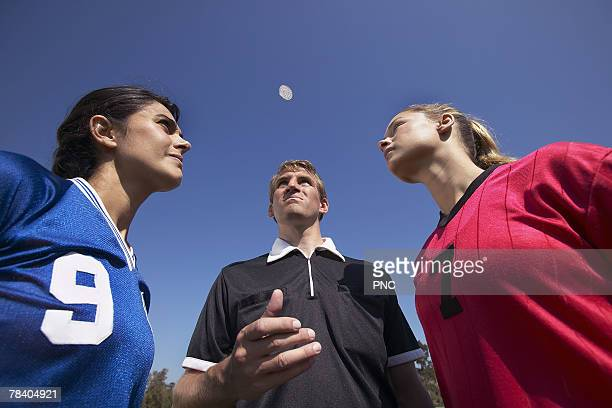 referee flipping coin - flipping a coin stock pictures, royalty-free photos & images