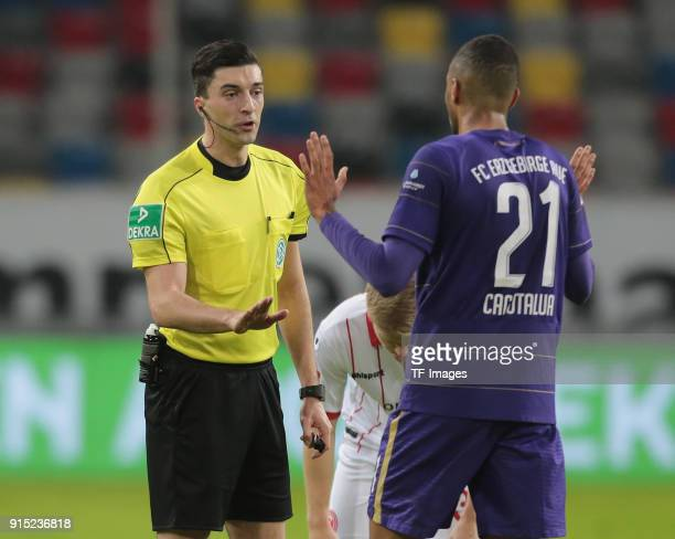 Referee Florian Badstuebner speaks with Malcolm Cacutalua of Aue during the Second Bundesliga match between Fortuna Duesseldorf and FC Erzgebirge Aue...