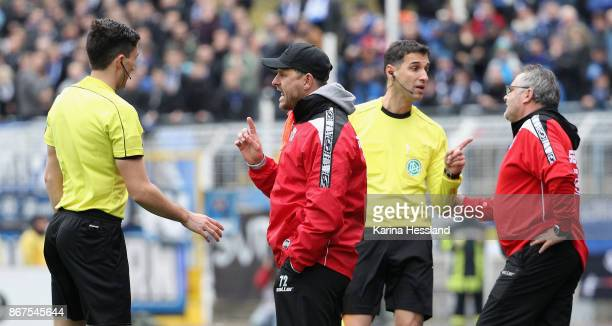 Referee Florian Badstuebner talks to Headcoach Steffen Baumgart of Paderborn during the 3Liga match between FC Carl Zeiss Jena and SC Paderborn 07 at...