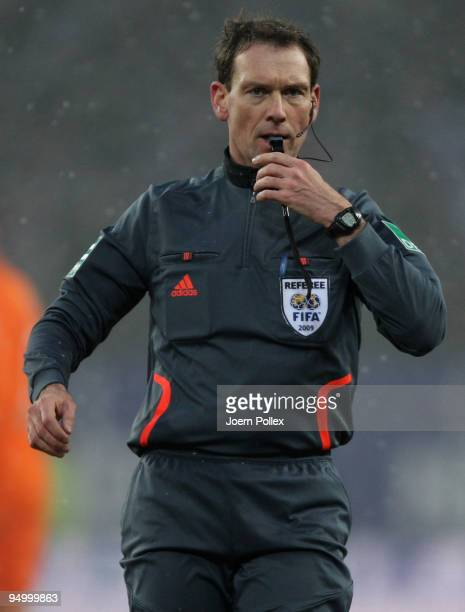 Referee Florian Meyer gestures ball during the Bundesliga match between Hamburger SV and Werder Bremen at HSH Nordbank Arena on December 20 2009 in...