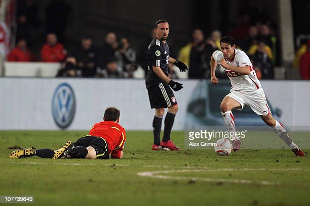 Referee Florian Meyer lies on the pitch as Christian Traesch of Stuttgart is challenged by Franck Ribery of Muenchen during the DFB Cup round of...