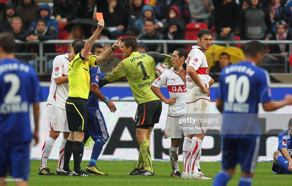 Referee Florian Meyer shows the red card to Mauro Camoranesi (3rdR) of Stuttgart during the Bundesliga match between VfB Stuttgart and Bayer Leverkusen at Mercedes-Benz Arena on September 25, 2010 in Stuttgart, Germany.