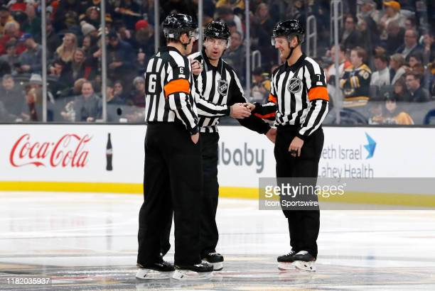 Referee Francis Charron linesman Brian Mach and referee Garrett Rank during a game between Boston Bruins and the Philadelphia Flyers on November 10...