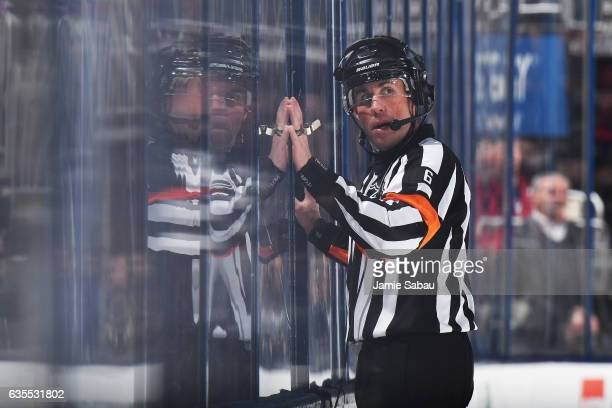 Referee Francis Charron reviews a goal during the first period of a game between the Toronto Maple Leafs and the Columbus Blue Jackets on February 15...
