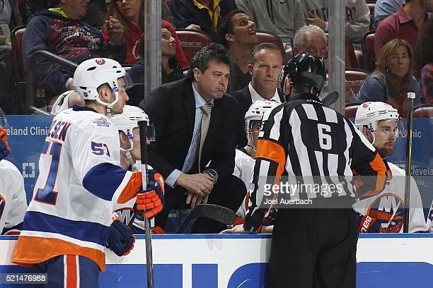 Referee Francis Charron talks to Head coach Jack Capuano of the New York Islanders regarding the fighting penalties against the Florida Panthers in...