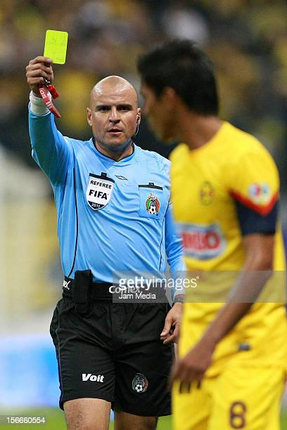 Referee Francisco Chacon reacts during a match between America and Morelia as part of the Apertura 2012 Liga MX at the Azteca Stadium on November 17...