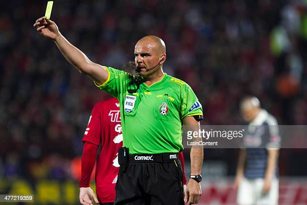 Referee Francisco Chacon show a yellow card during a match between Tijuana and Chivas as part of the 10th round Clausura 2014 Liga MX at Caliente...